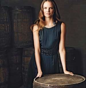 19018201b50 Woman wearing a black bejeweled silk-and-satin dress by BCBG in a winery