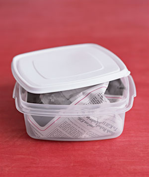 Newspaper in a food container