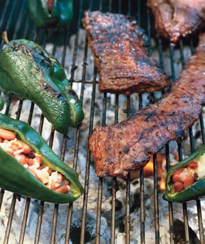 Ribs and peppers on a grill