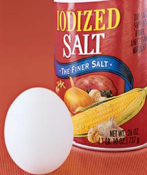 An egg and a canister of salt