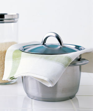 Folded towel absorbs excess moisture from pot
