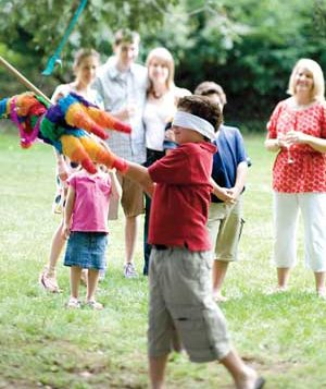 Boy swinging at a pinata