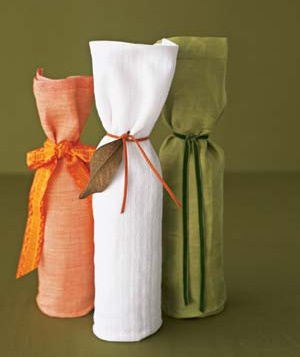 Wine bottles wrapped with dish towels