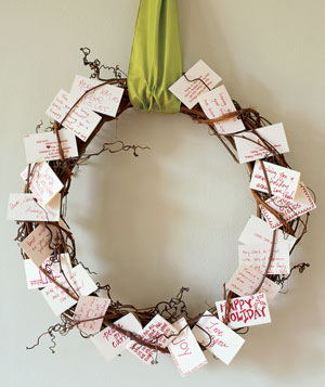 Twig wreath with holiday wishes on small cards
