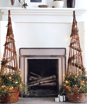 Twinkling topiaries next to a fireplace