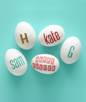 Easter eggs decorated with letter stickers