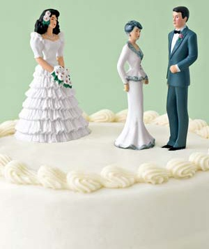 Figurines of bride, groom and groom's mother on a wedding cake