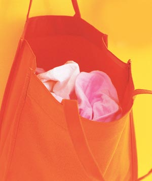 Orange cloth shopping bag filled with rags
