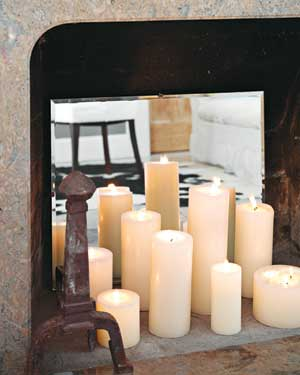 Candles displayed in front of a mirror