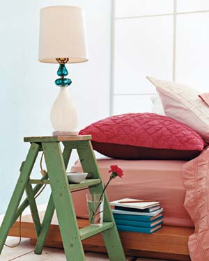 Bed with a step ladder as a night stand