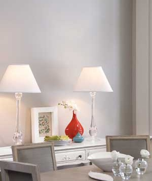 A pair of lamps on a side table in a dining room
