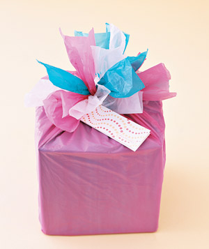 Box decoratively wrapped using plastic bags