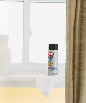 Can of spray lubricant on a window ledge