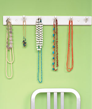 Necklaces hanging on a coat rack