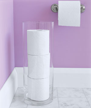 Rolls of toilet paper stored in tall vase