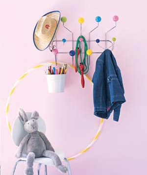 Toys and kid's jacket hanging on a colorful coat rack
