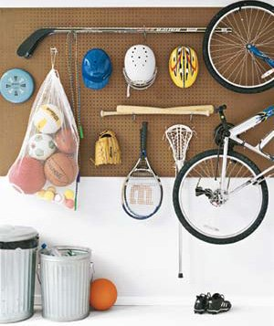 Sports equipment on a pegboard in a garage
