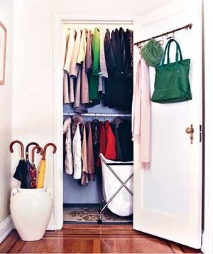 Arranged closet with clothes