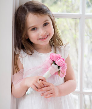 Girl in white dress with pink flowers