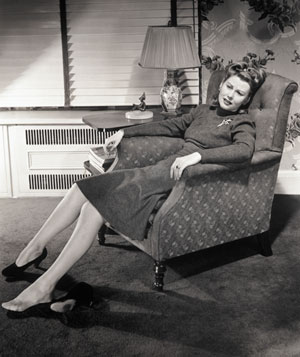 Woman reclining with one shoe off