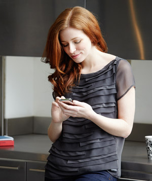 Woman texting on smartphone