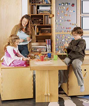 Mom with children in play room