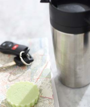 Car travel mug, keys, map and air freshener