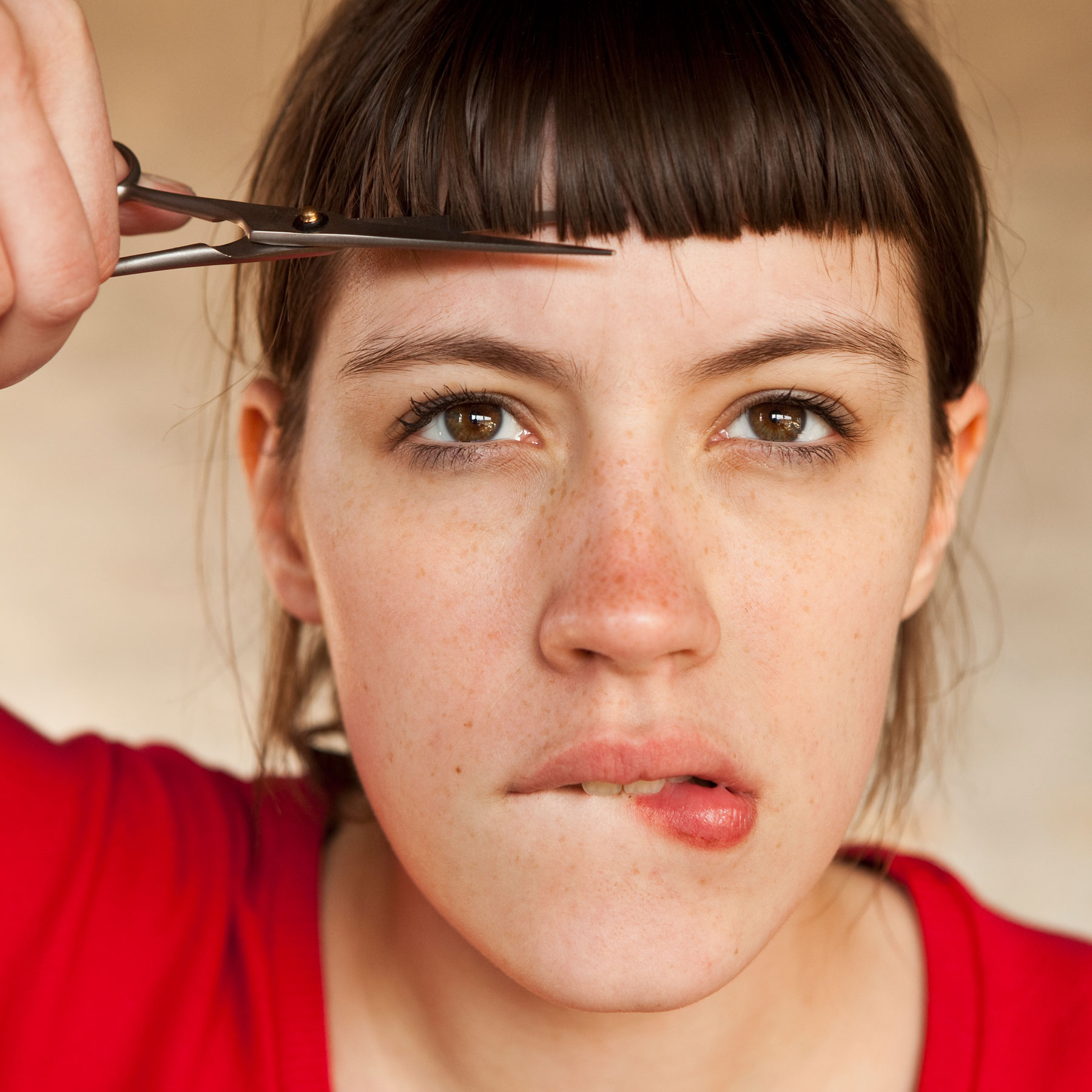 Quarantine haircut: Should you cut your own hair during quarantine (woman with bad bangs)