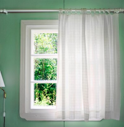 A White Curtain In Front Of Window Green Room