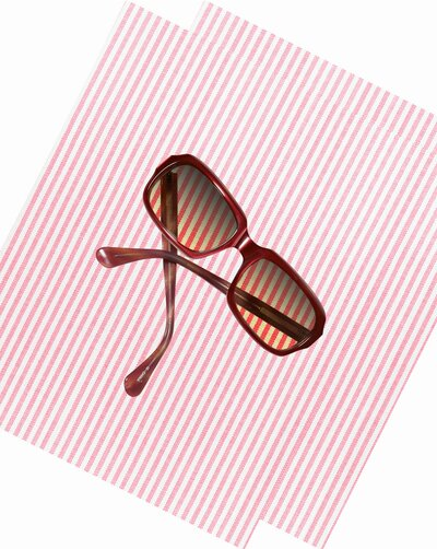 d82ccb689aa Sunglasses on pink striped background