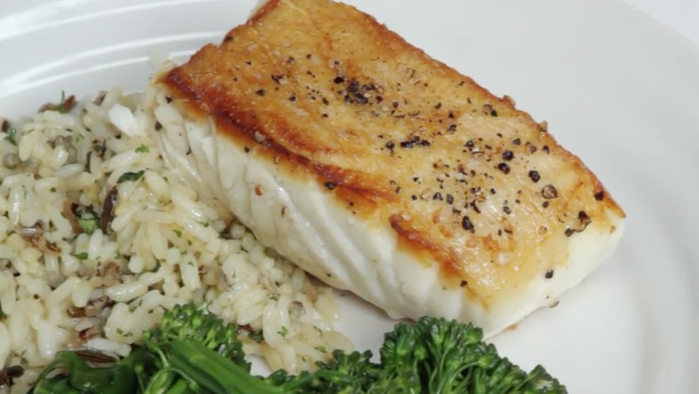 Cooked fish with broccoli and rice