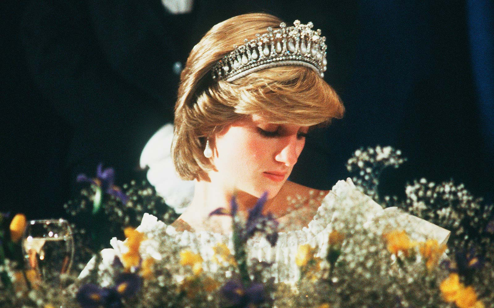 Diana, Princess of Wales wears the Cambridge Lover's Knot tiara (Queen Mary's Tiara) and diamond earrings during a banquet