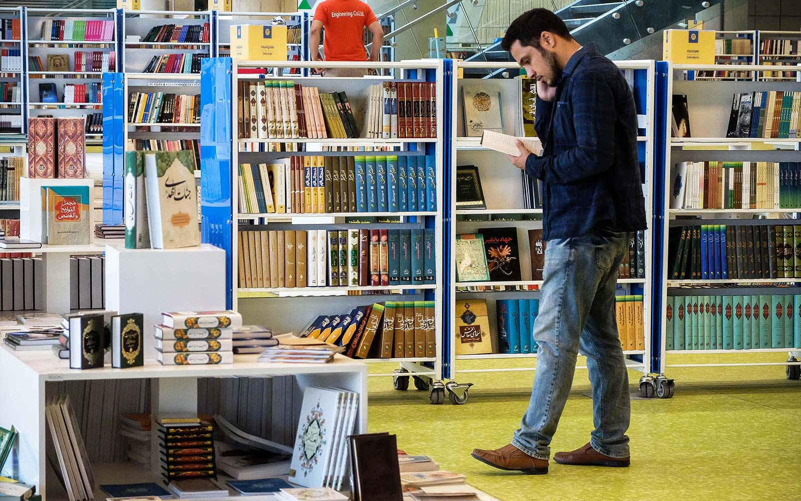 People look at books at Tehran's Book Garden, a new giant academic complex in Iran. The 65,000 square-meter center has several movie theaters, science halls, a restaurant, a prayer room and million books
