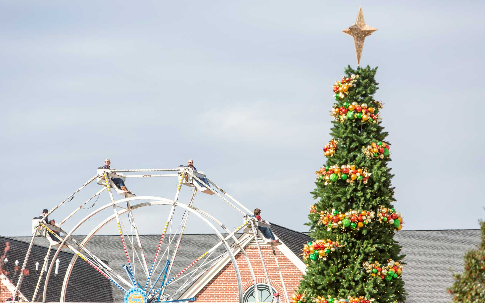 December 03, 2016 Rock Hill, SC Children and adults enjoy the ferris wheel Christmasville in Old Town