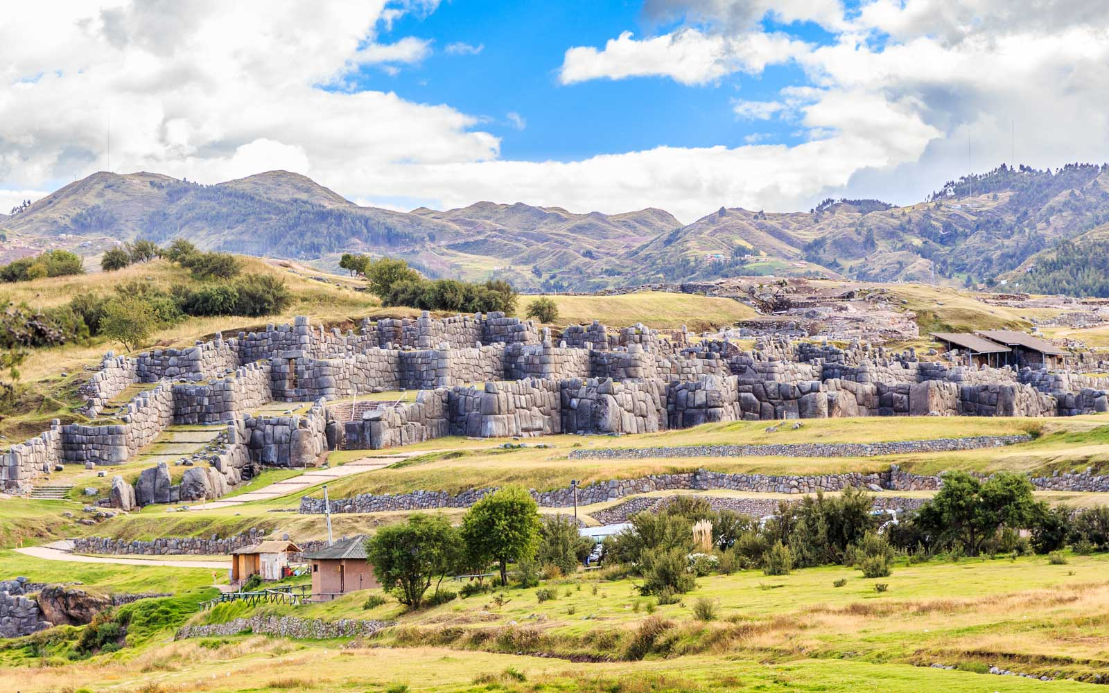 Ruins of Inkan fortress Saksayhuaman with mountains in background, Cuzco, Peru