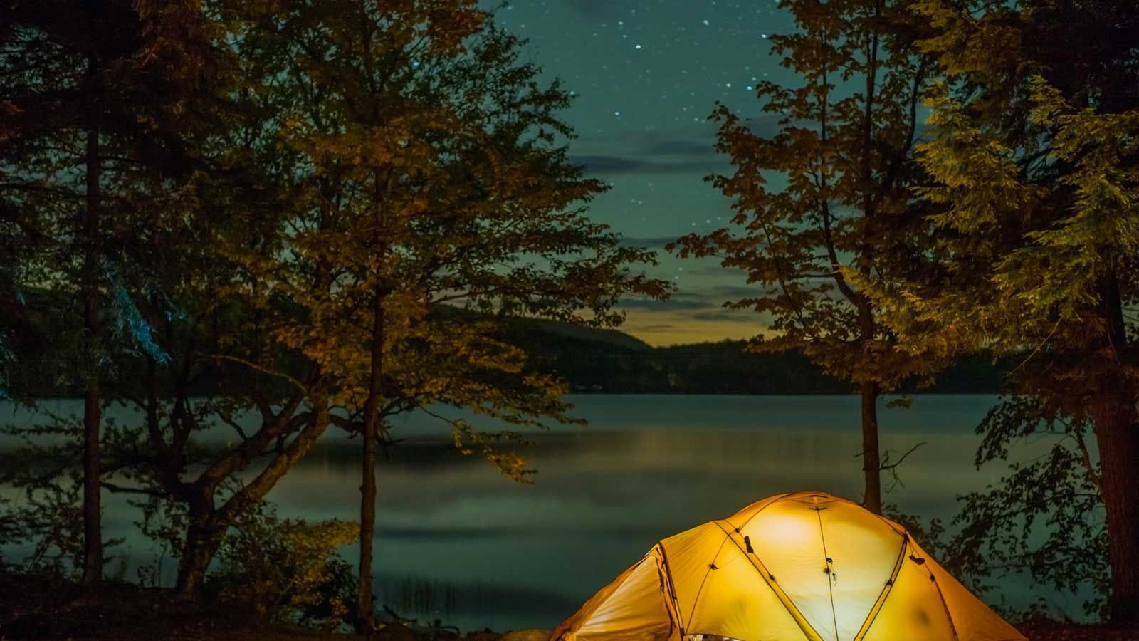 Tent camping in the great outdoors under a starry sky
