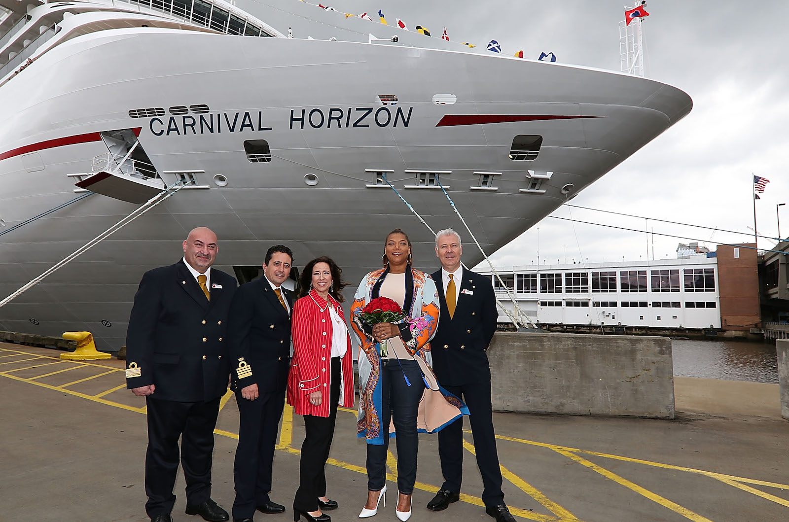 Pierre Camelleri, Luigi De Angelis, Carnival President Christine Duffy, Queen Latifah and Rosario Capilli pose next to Carnival's newest ship during its U.S. debut and naming celebration for the Carnival cruise ship Horizon at Pier 88 on May 23, 2018