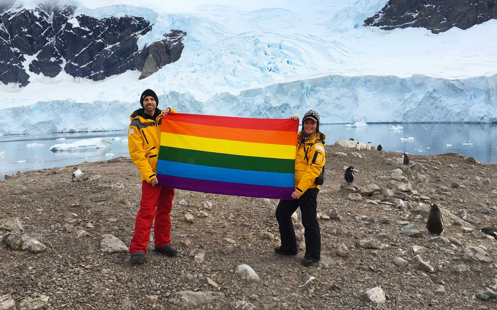 Pride flag in Antarctica, with Planting Peace founder Aaron Jackson