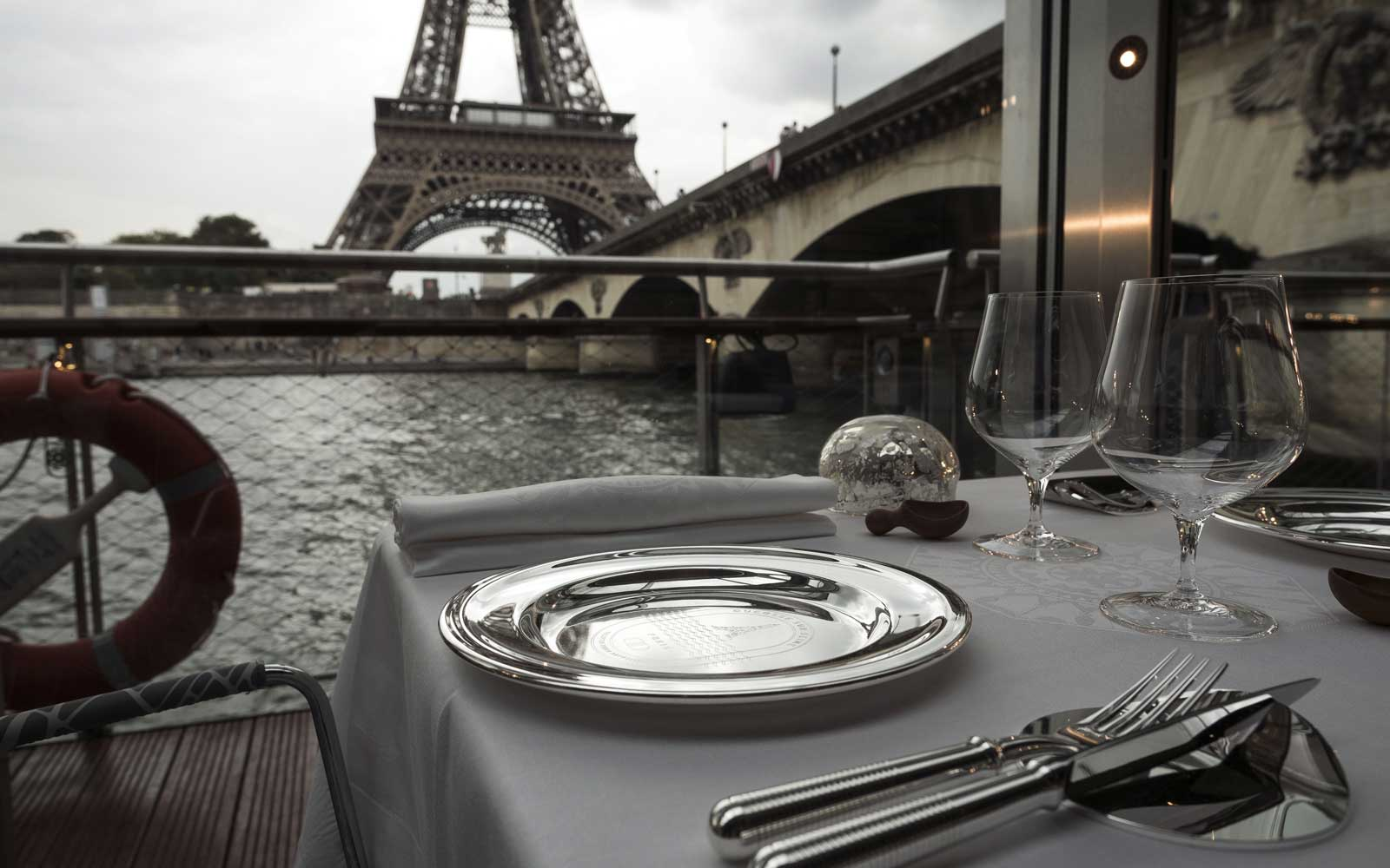 A dressed table is seen at French chef Alain Ducasse's new boat restaurant, the  Ducasse sur Seine , on August 30, 2018 in Paris, next to the Eiffel tower