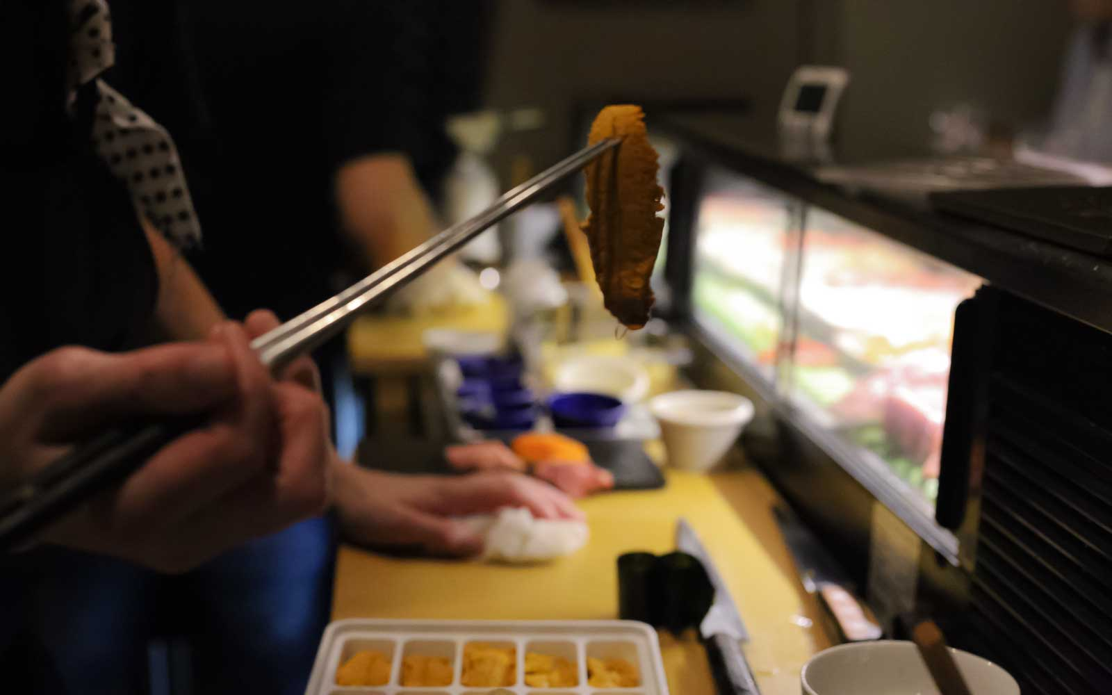 Chef David Bouhadana prepares a dish for the 12-piece omakase at Sushi by Bou at Sanctuary Hotel.