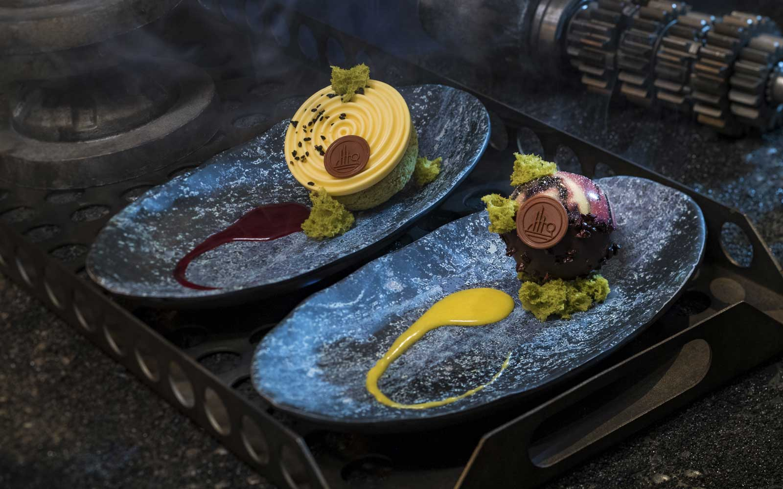 Guests can indulge in a raspberry crème puff with passion fruit mousse (left) or chocolate cake with white chocolate mouse and coffee custard (right) at Docking Bay 7 Food and Cargo inside Star Wars: Galaxy's Edge.