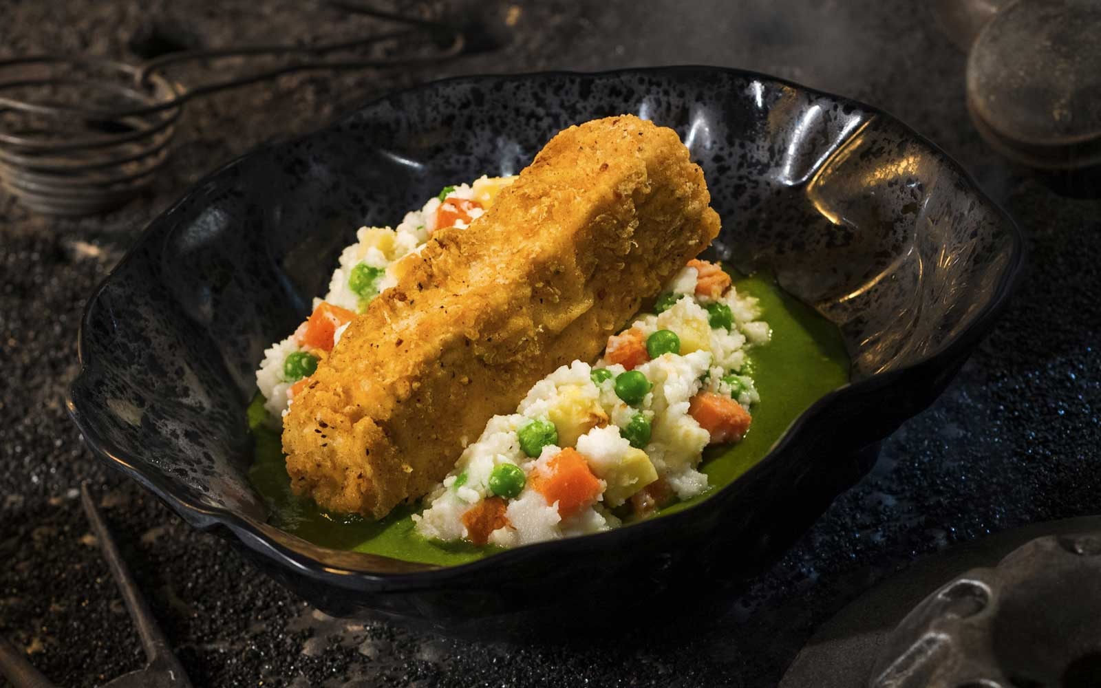 The Fried Endorian Tip-Yip, found at Docking Bay 7 Food and Cargo inside Star Wars: Galaxy's Edge, is a decadent chicken dish with roasted vegetable mash and herb gravy.