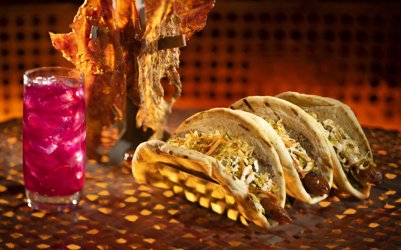 The Meiloorun Juice, the Turkey Jerky and the Ronto Wrap filled with spiced grilled sausage and roasted pork found at Ronto Roasters, located in the Black Spire Outpost market inside Star Wars: Galaxy's Edge.