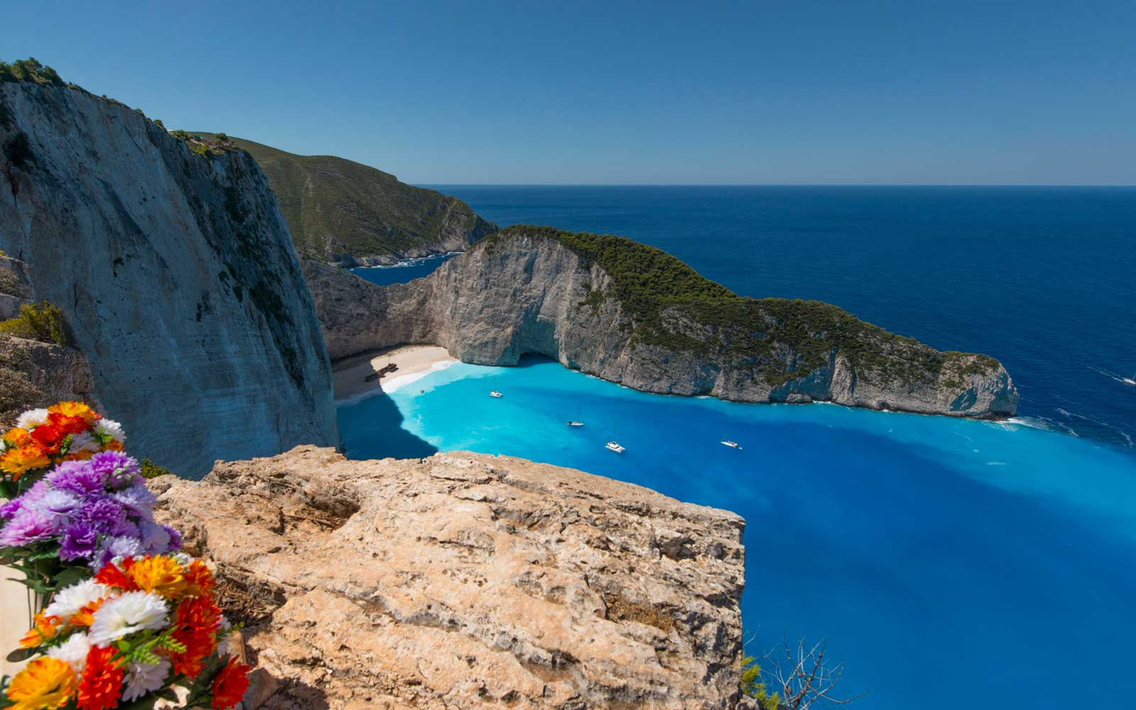 Explore tucked-away locations like Navagio Beach.