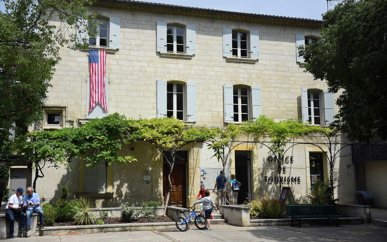 The U.S. flag is displayed on the tourist office of Villeneuve-les-Avignon, southern France on June 15, 2019, as the former US president Barack Obama and his family visit the city for a week's vacation.
