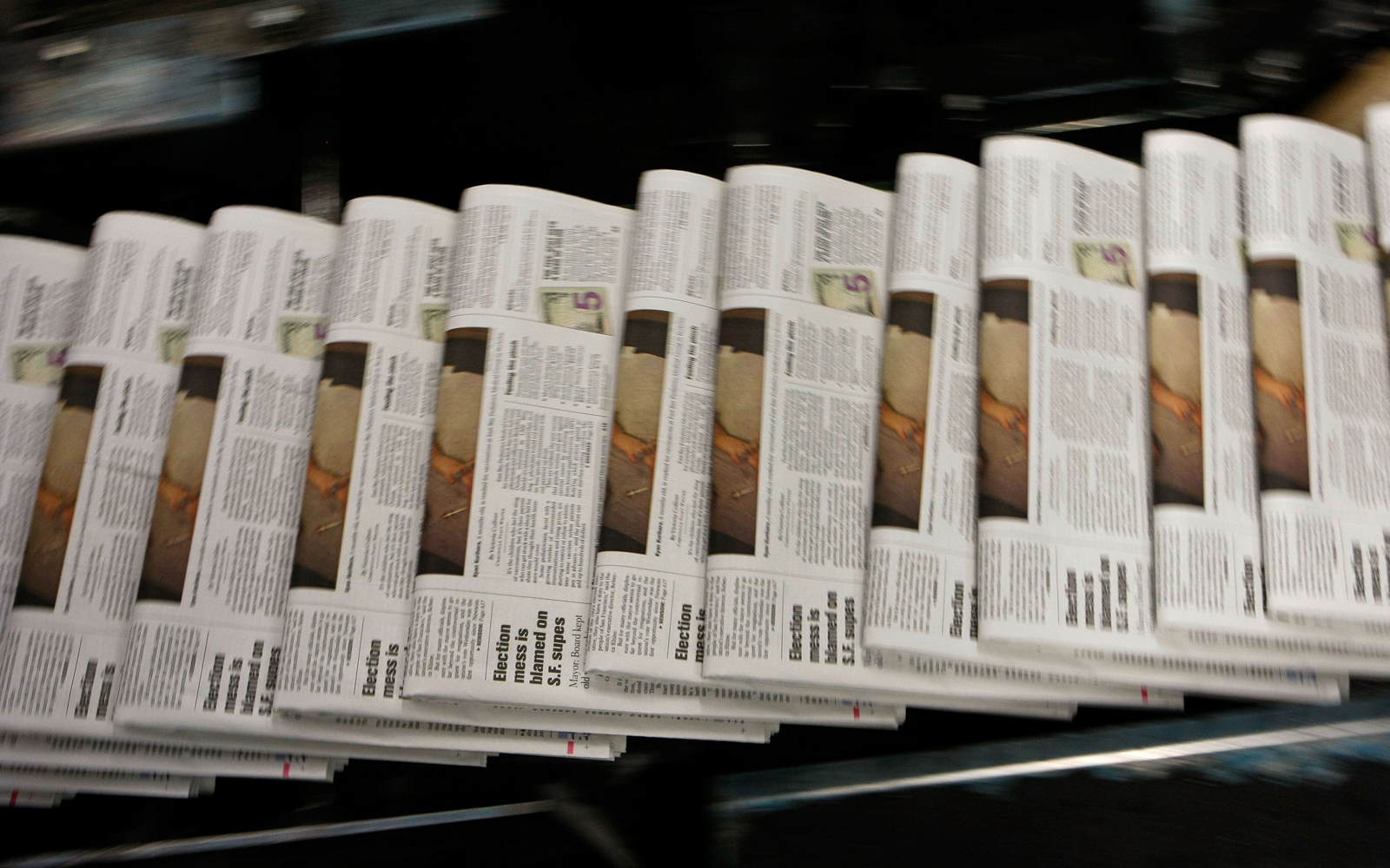 Newspapers on a printing press