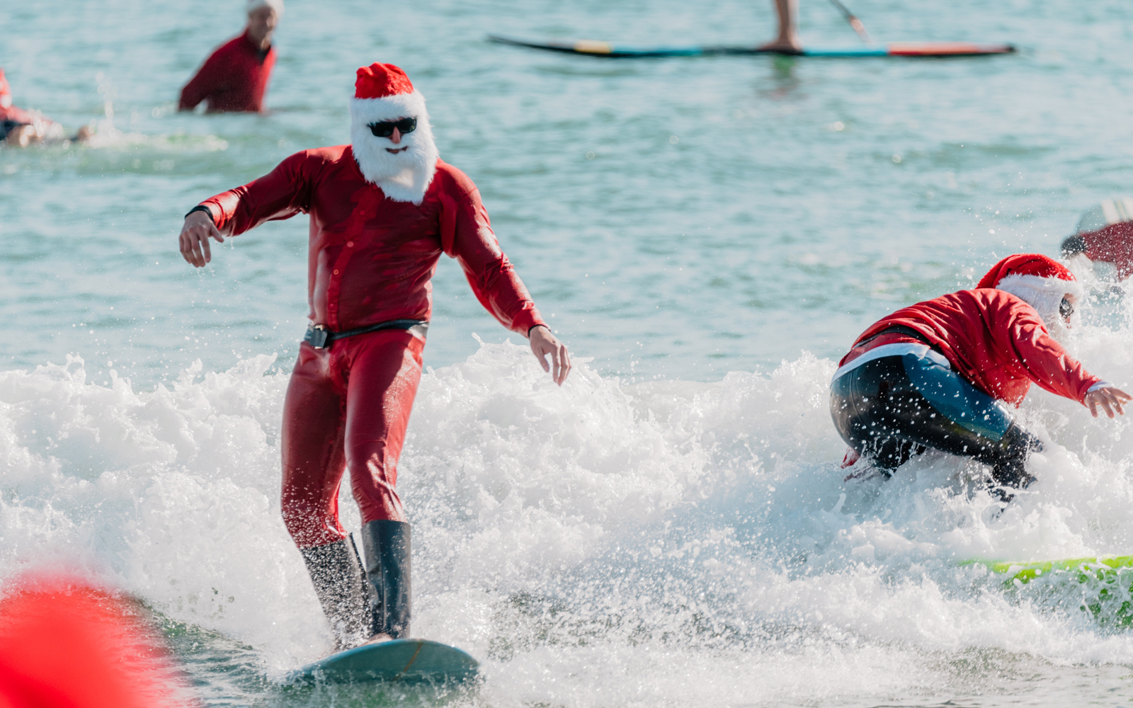 Santa Claus surfing at annual Surfing Santas event