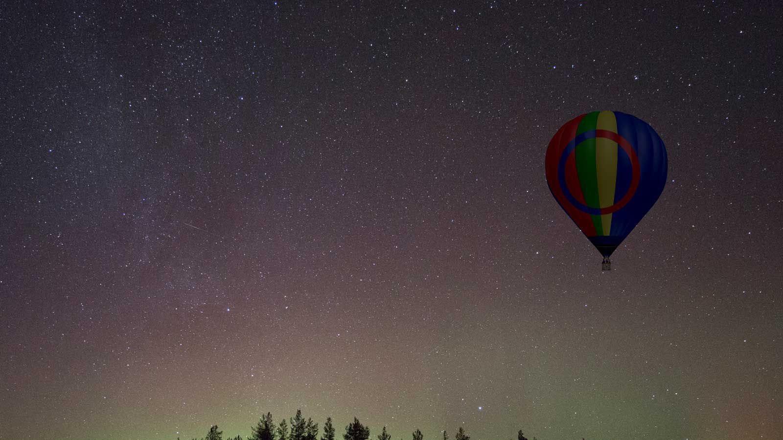 Hot air balloon during the norther lights in Lapland