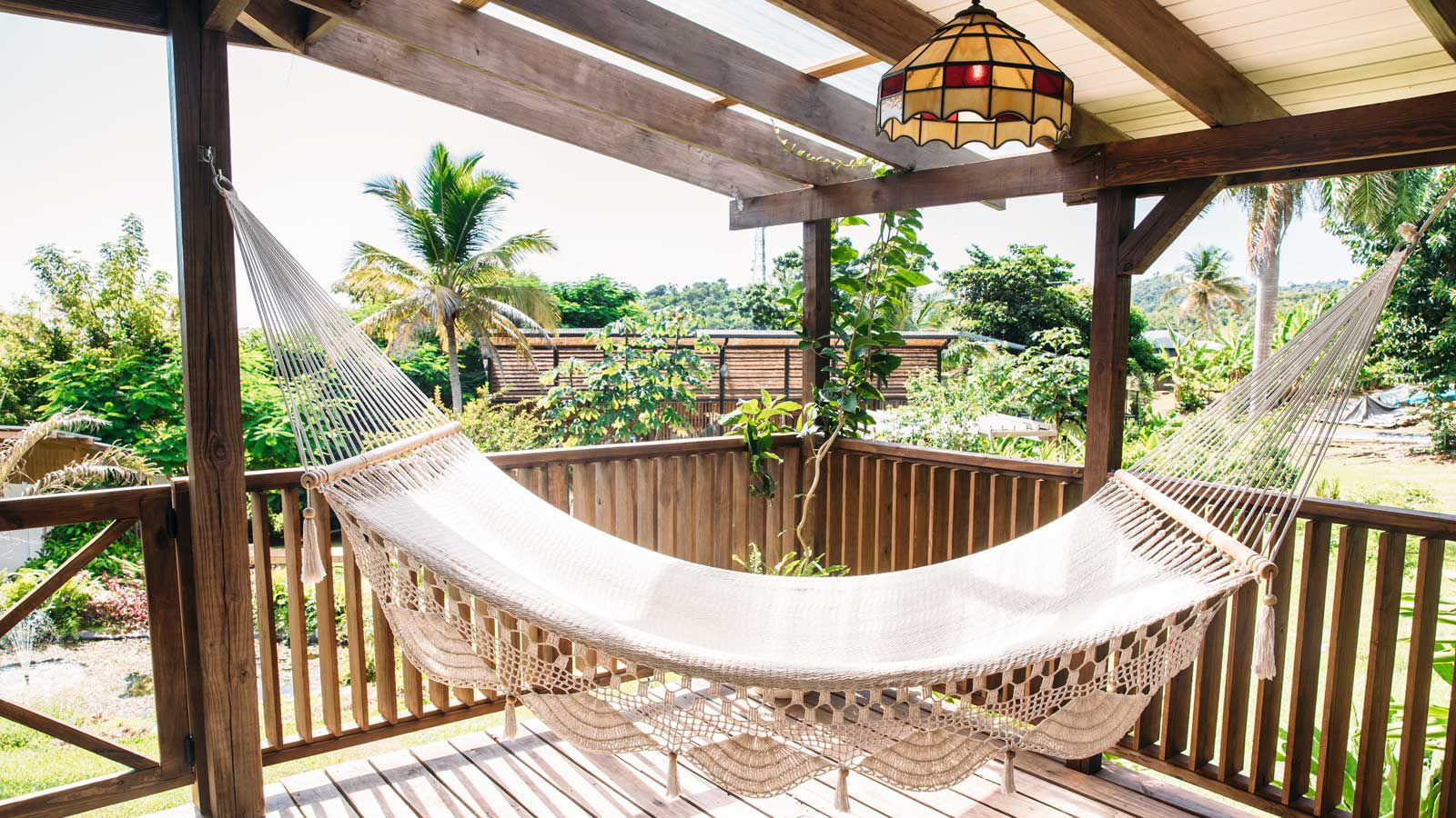 A hammock overlooking greenery on the balcony of the Finca Victoria hotel in Vieques, Puerto Rico