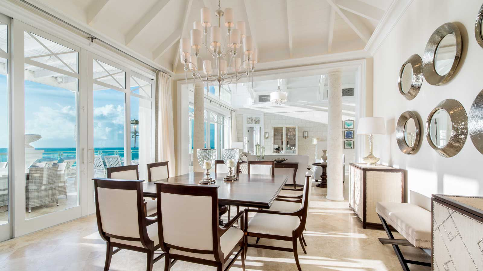 The almost all-white dining space in a suite at The Shore Club in the Turks and Caicos, with views to the ocean